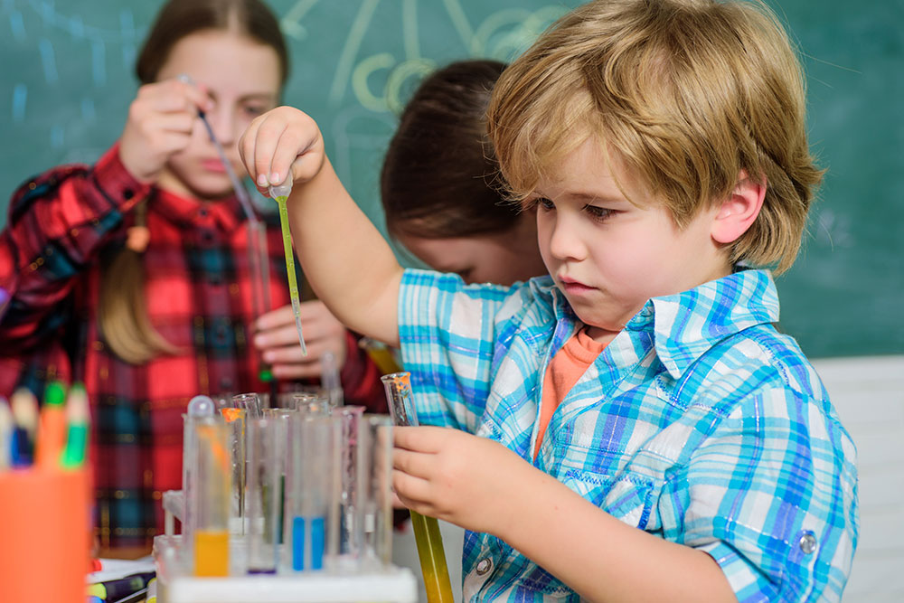 Child Doing Experiment in Claus' Classroom